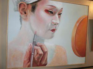 化粧をする芸者の絵